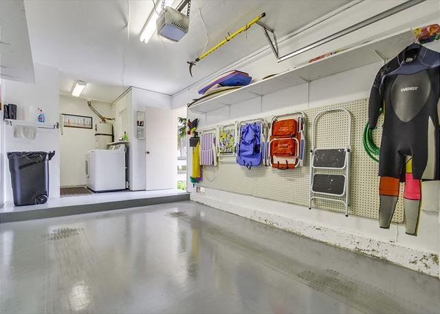 Garage with beach chairs & boogie boards