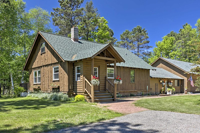 Escape to this 4-bedroom, 2-bathroom vacation rental house in St. Germain for the ultimate lake retreat!