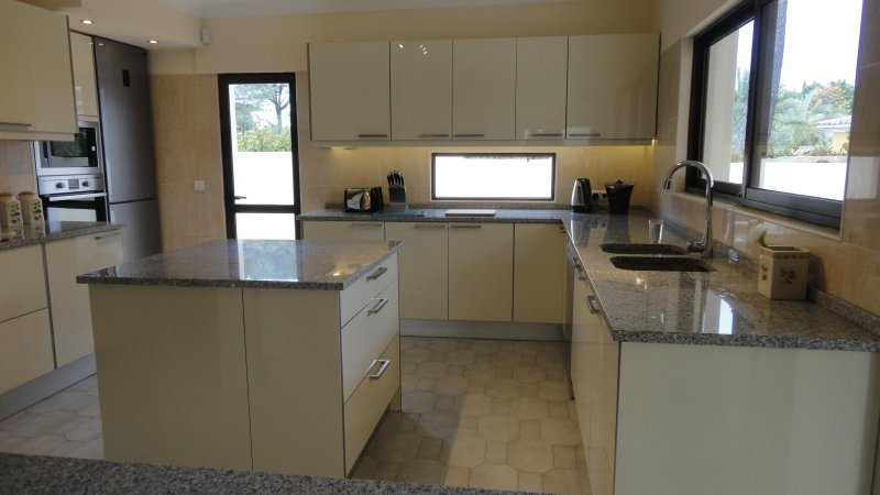 New Kitchen with lovely views over the garden and golf course.Outside built in BBQ.
