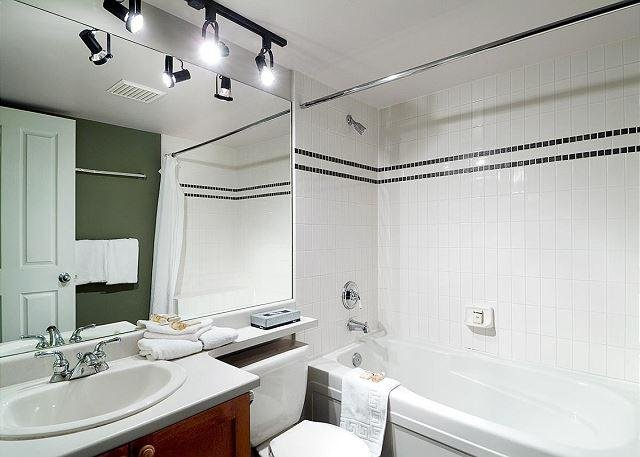 A full bathroom and an in-suite washer and drier.