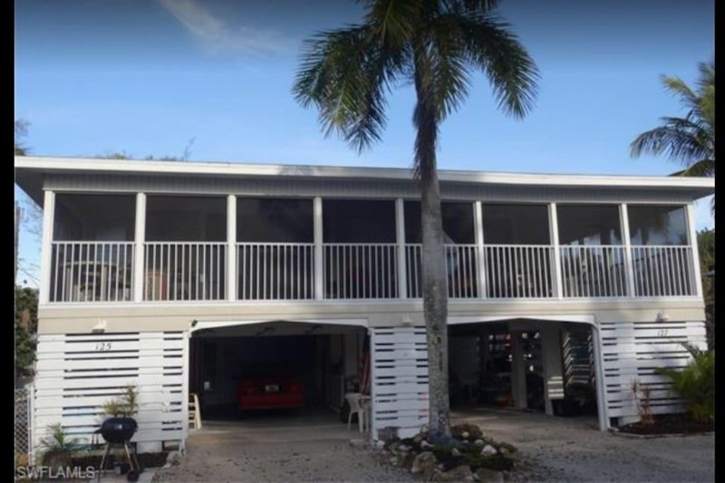 This rental unit is located on the street level, its access is through the left carport