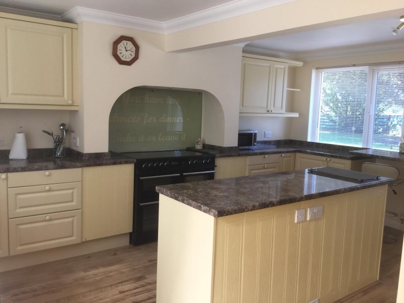 Fully equipped modern kitchen with central island, electric range cooker, double fridge-freezer