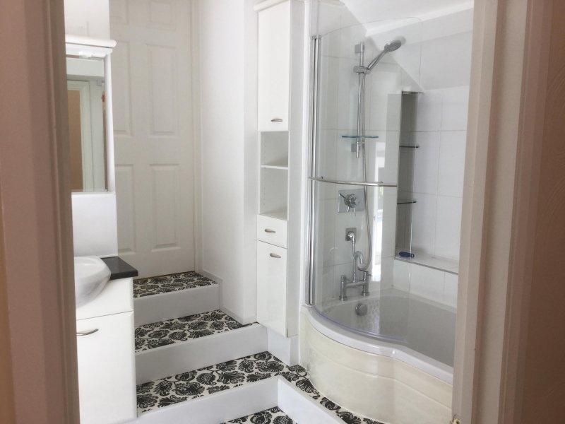 Ensuite bathroom, bath and power shower