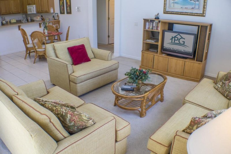 The Family Room,With a 32' Flat Screen TV,DVD and Patio Doors to the Pool.
