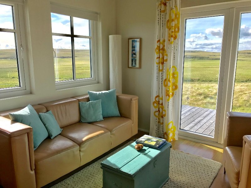 Sitting area with a view onto mount Hekla and surrounding pastures.