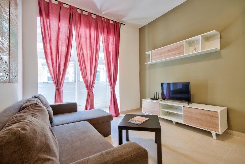 Classy and bright 3-bedroom, location de vacances à Il Gzira