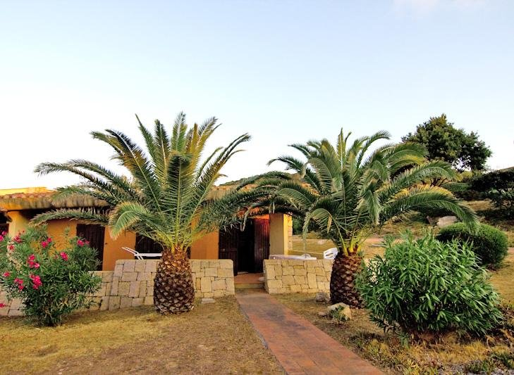 Villetta con terrazzo e giardino sul mare, aluguéis de temporada em Palau