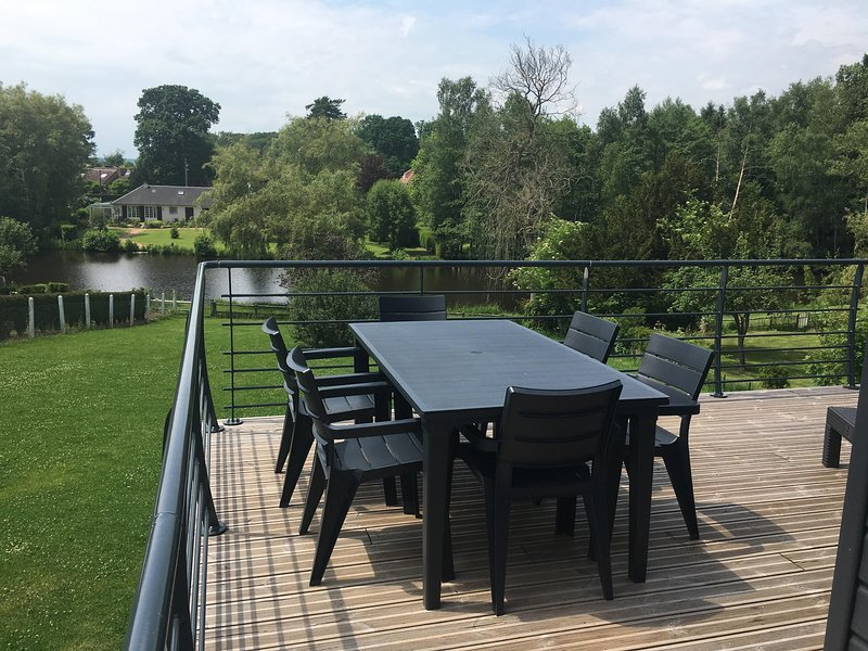 A altura terraço: sala de jantar e sala de estar