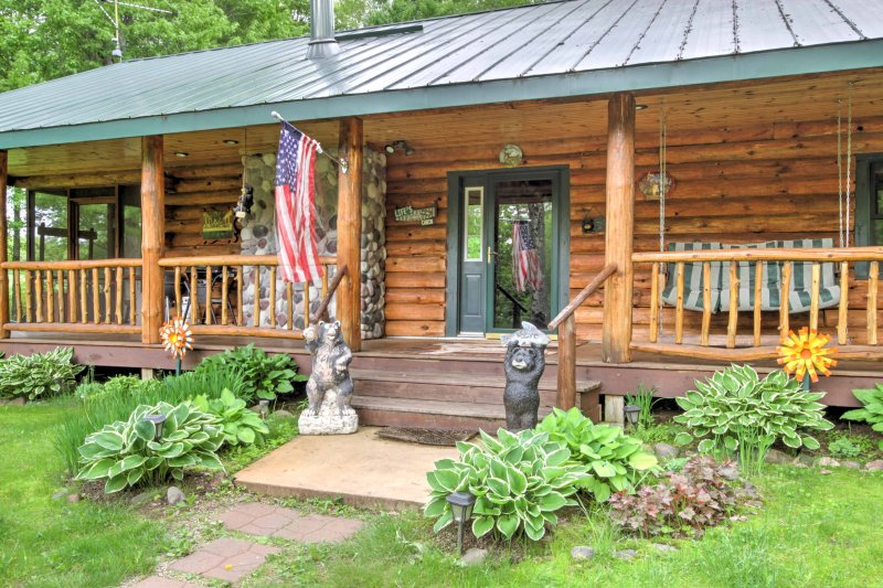 This 2-bedroom, 1-bathroom cabin sits on a 2-acre lot in Holcombe, Wisconsin,  near Lake Holcombe.