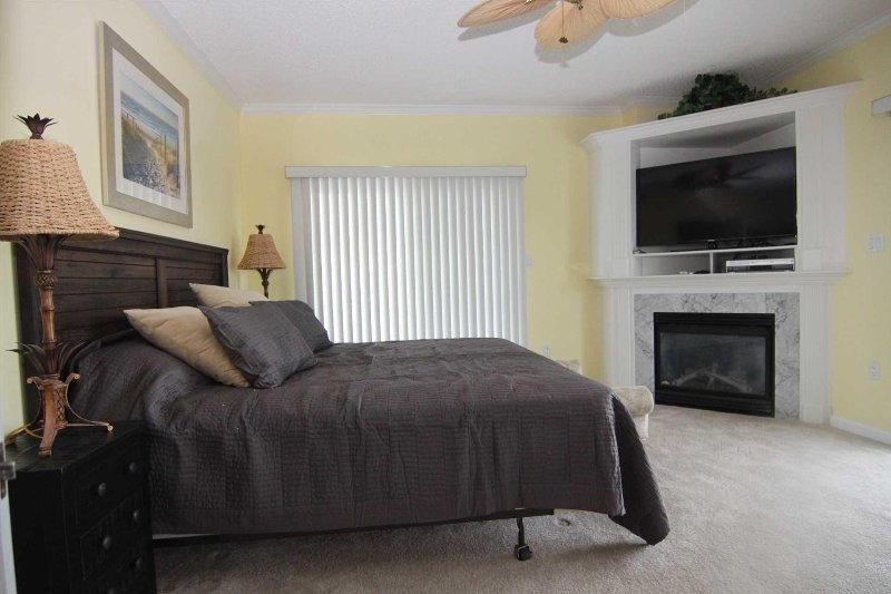 Master Bedroom with Fireplace and Flat Panel TV