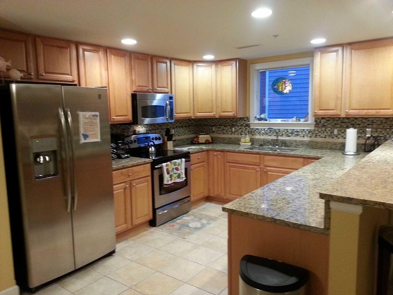 Large Modern Kitchen Granite Counters with Stainless Appliances