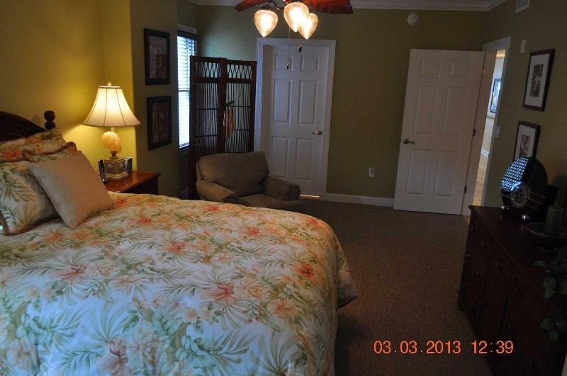 Bedroom 3 showing shared bathroom door to left and hallway through door on right