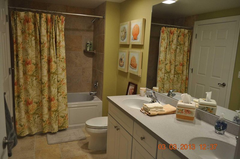 Bath opens to bedroom 3 and halllway