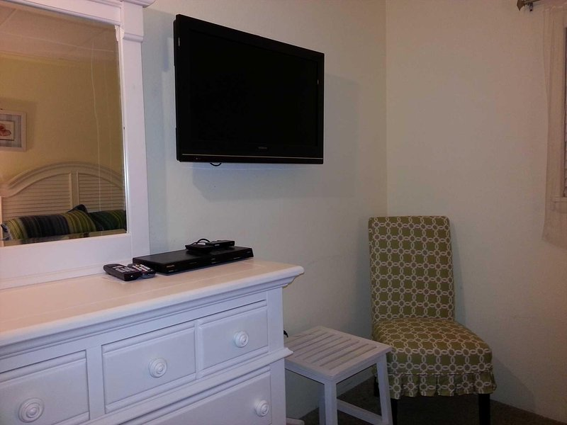Other side of bedroom 2 with wall-mounted HD TV