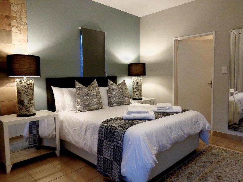 Main bedroom with queen size bed and en-suite bathroom