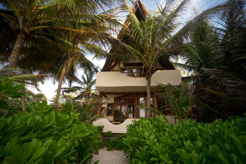 Casa Bonita is right on the beach with gorgeous green foliage for privacy.