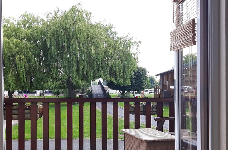 Relax in the lounge and gaze at the wonderful willow trees along the river bank