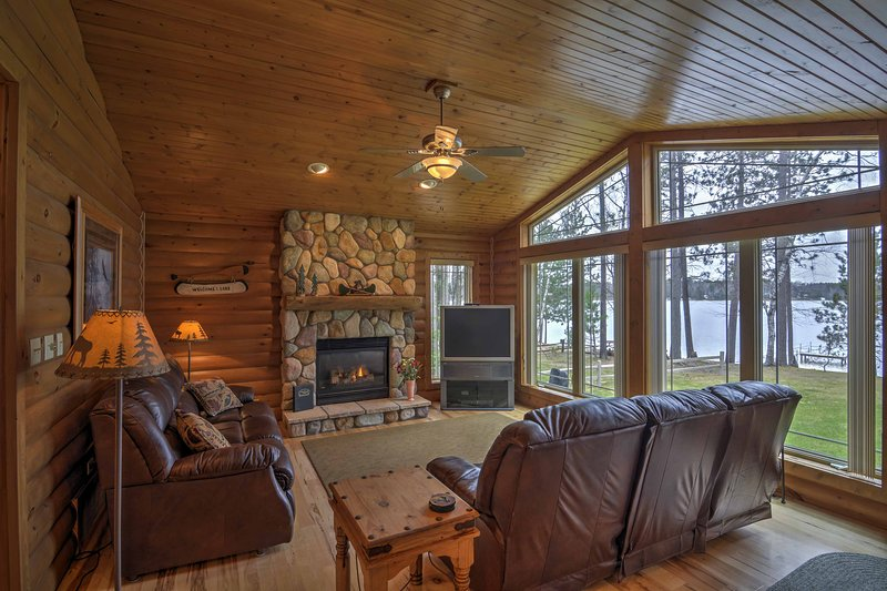 Warm up beside the large stone fireplace and enjoy the nature views.