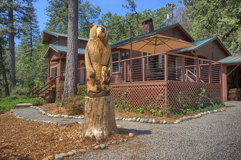 1,800-square-foot cabin with a large, carved bear