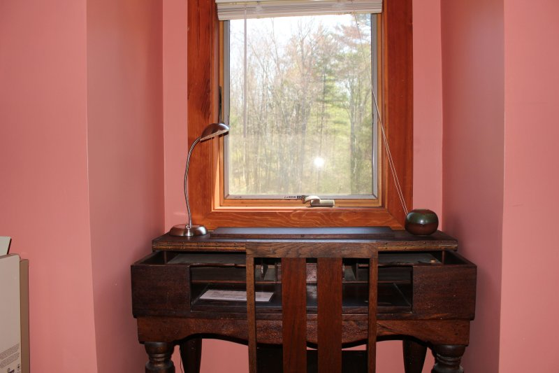 This spinet once held a harpsichord.  This window looks out onto the east pasture and the woods.