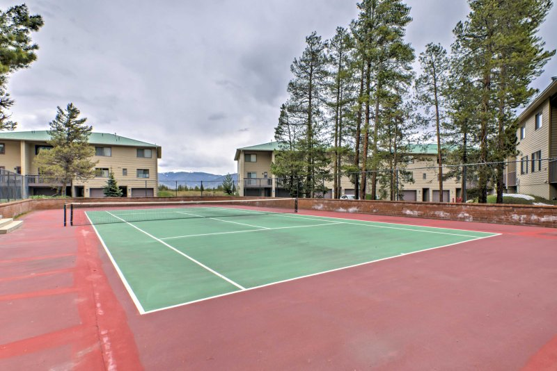 In the warmer months, guests can use the community tennis court.
