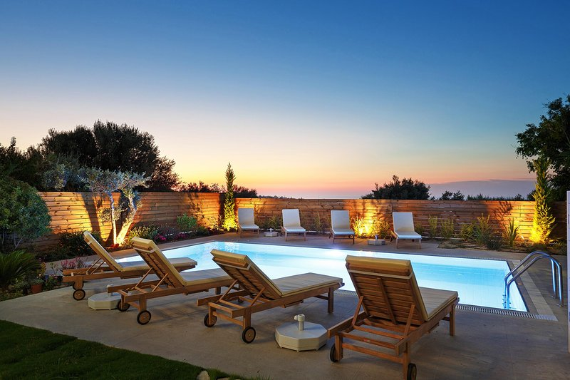 The private swimming pool by the sunset