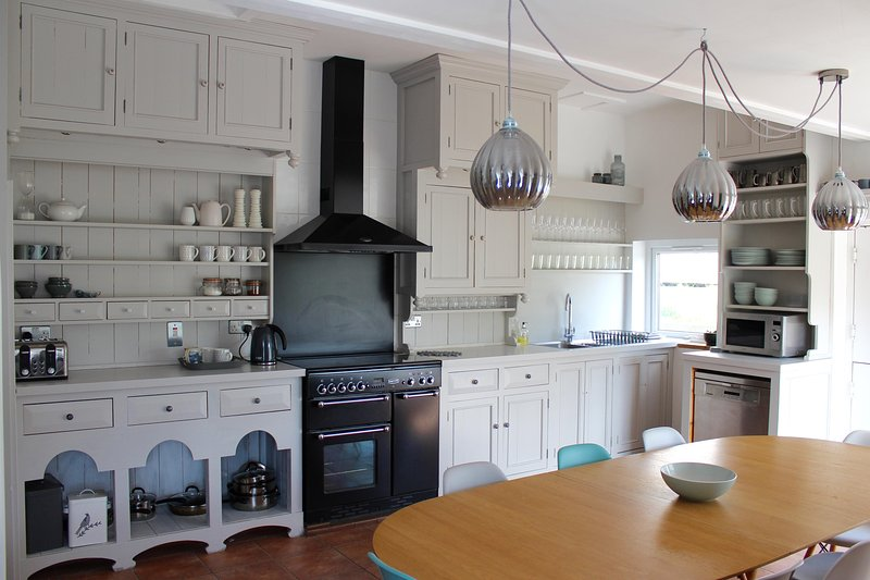Spacious kitchen dinner with range cooker.  Very well equipped with second table so seats 10 + views