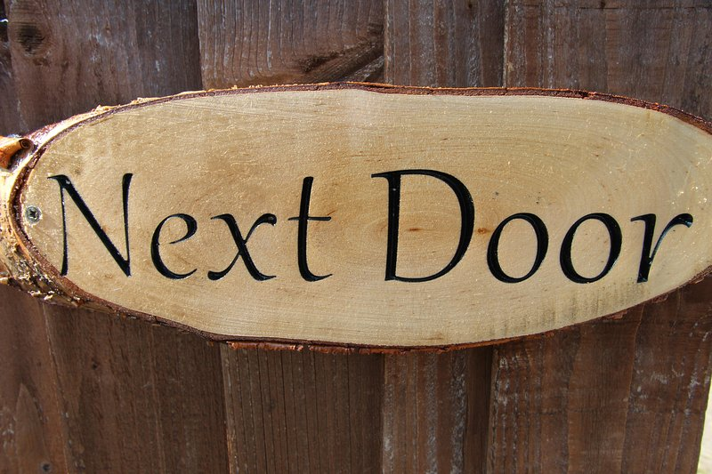 Next door rear access sign