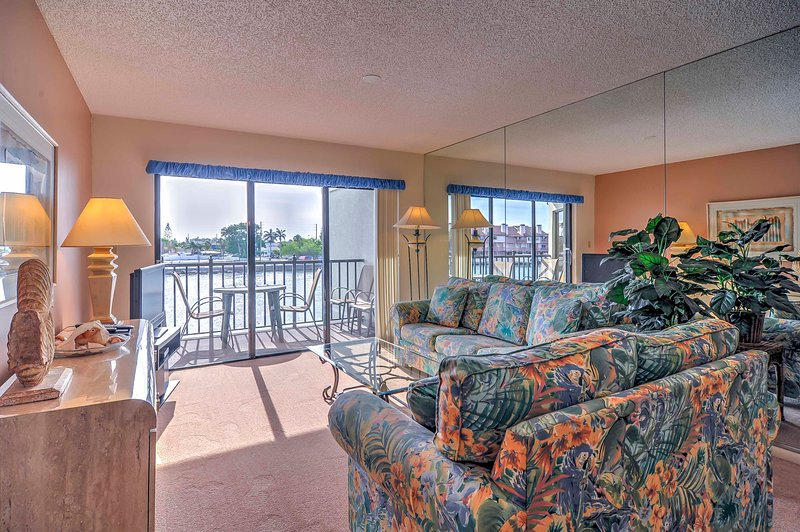 The vibrant living room offers pleasing views of the sparkling water.