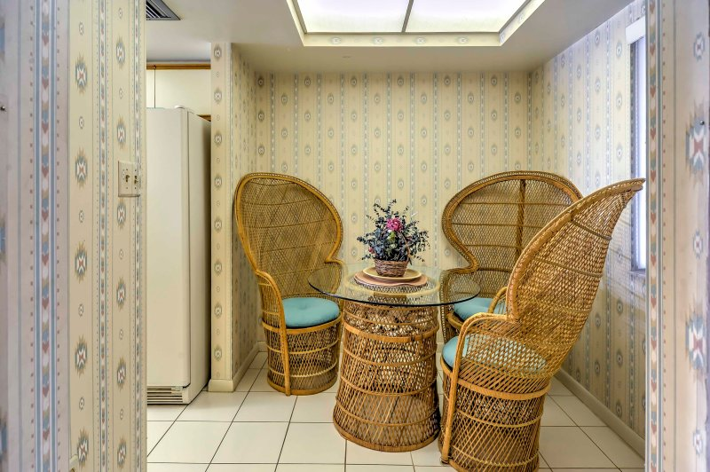 Thatched furnishings along with vibrant patterns create a coastal ambiance for the home's interior.