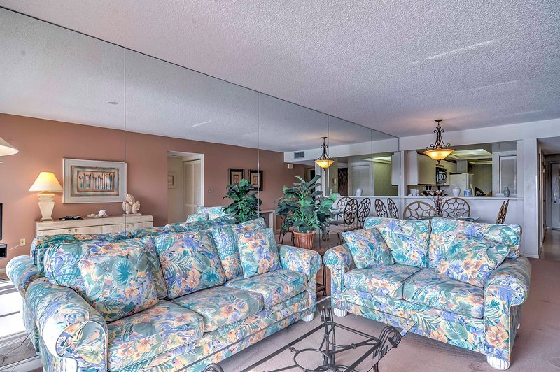 Sprawl out on these comfortable sofas for an at-home movie night in front of the flat-screen cable TV.
