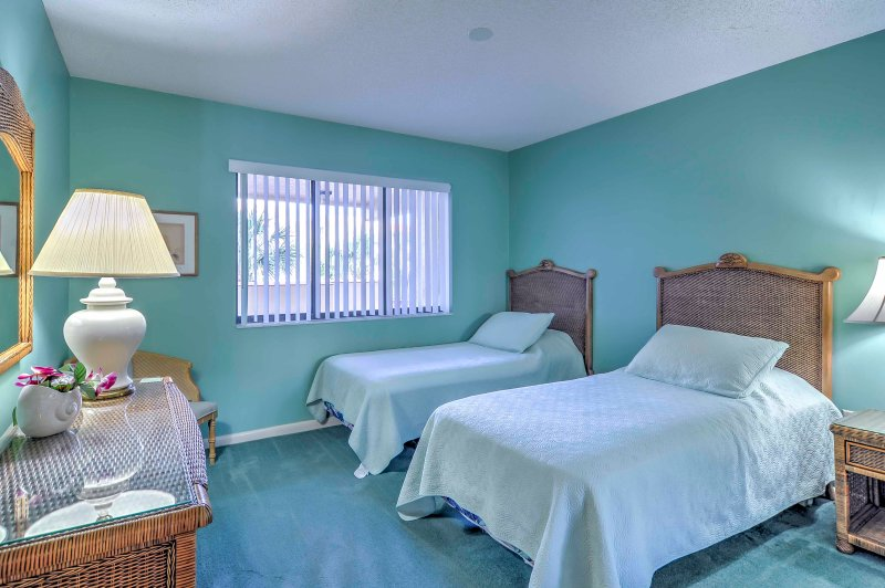 The second bedroom comes equipped with 2 cozy twin beds.