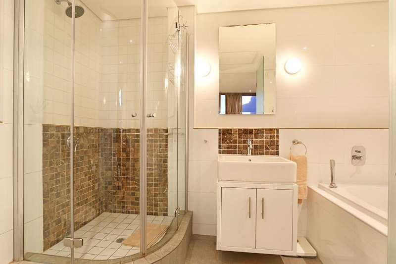Two bathrooms; this one with a shower and bath