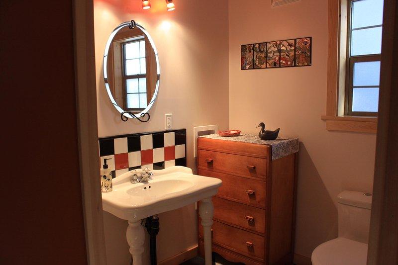 bathroom with shower on main floor