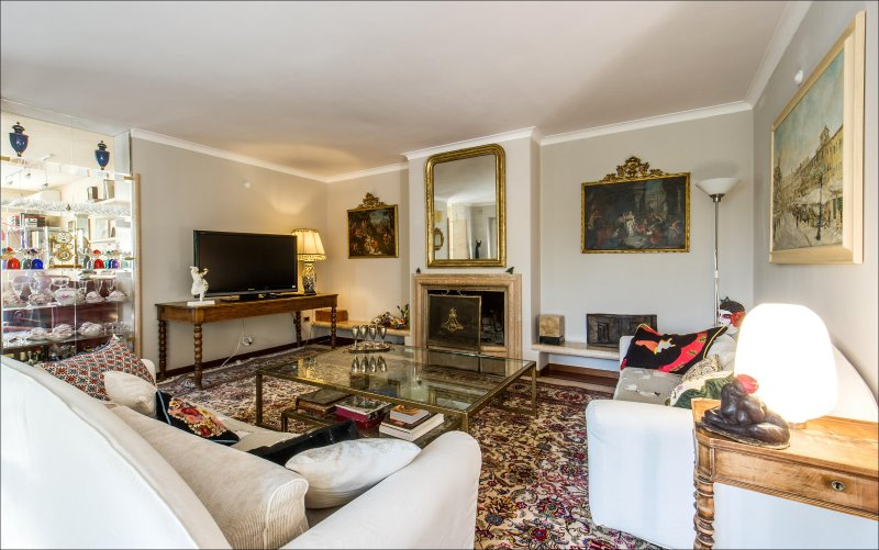 living room with fireplace and art works