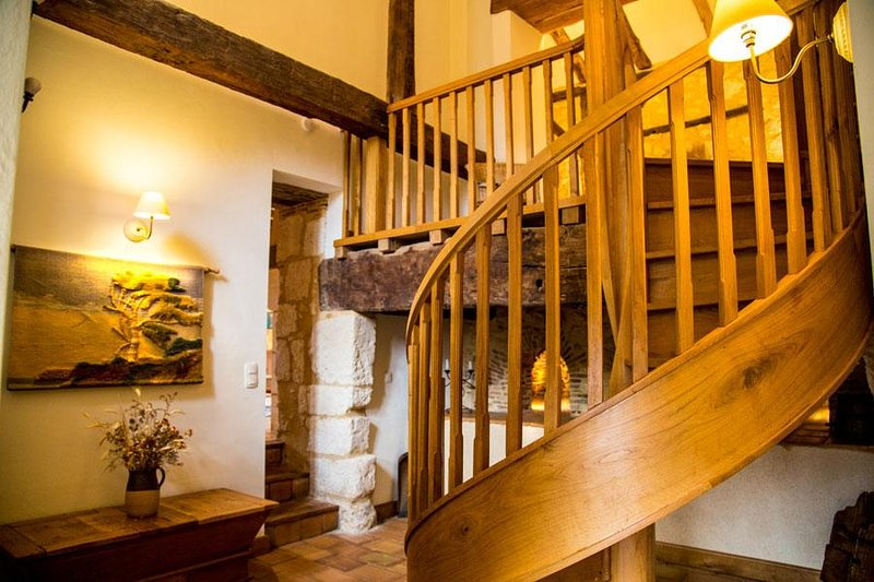 The oak spiral staircase leading to the mezzanine bedroom