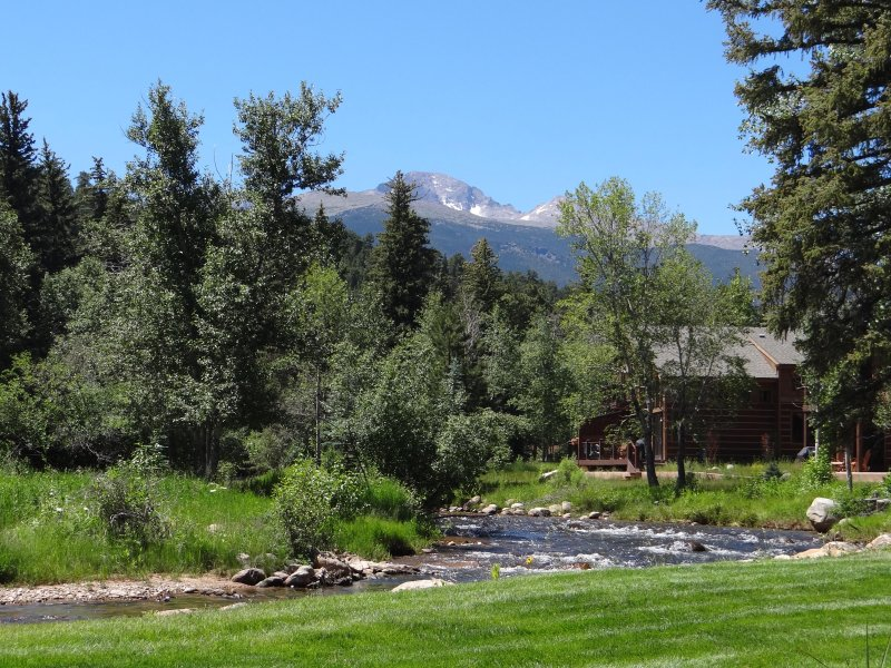 View from deck looking towards Longs Peak and river