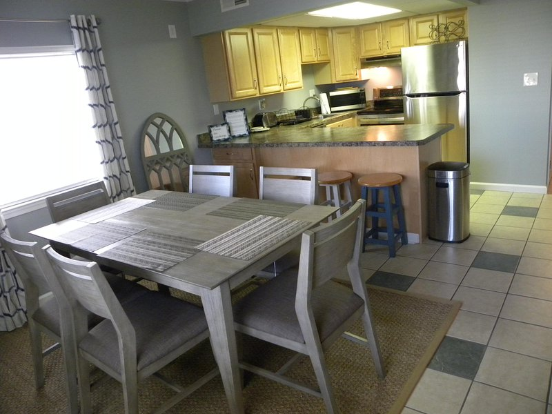 Full kitchen and large dining room table. A game of cards perhaps?