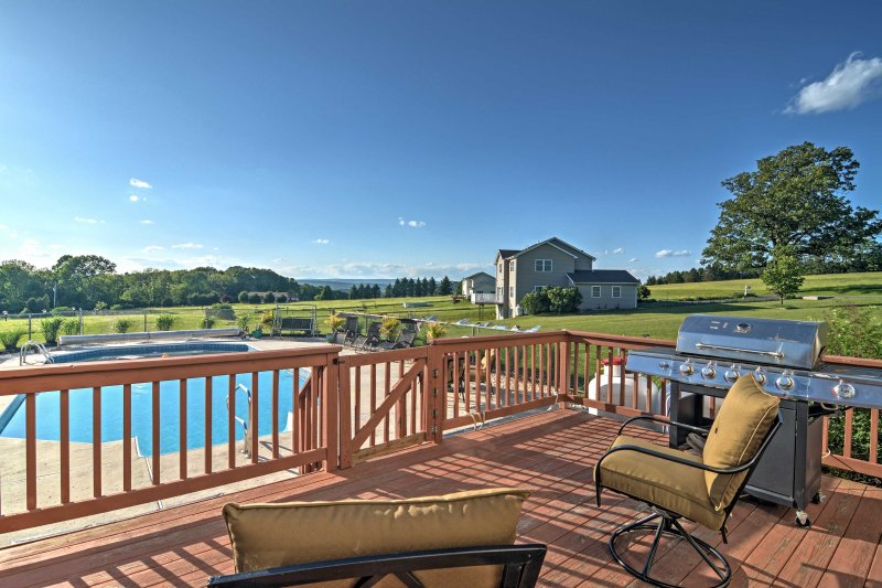 Enjoy access to a deck and pool at this Saylorsburg vacation rental home!