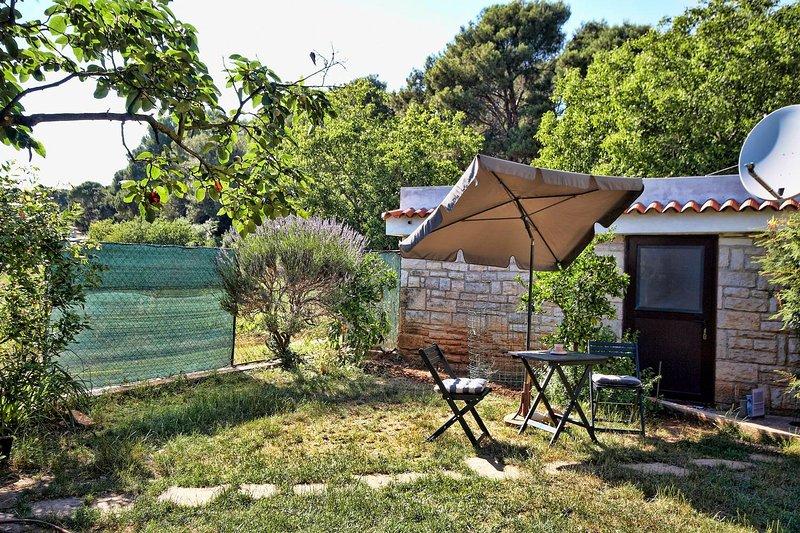 Entrada com um jardim privado (entrada não 1.)