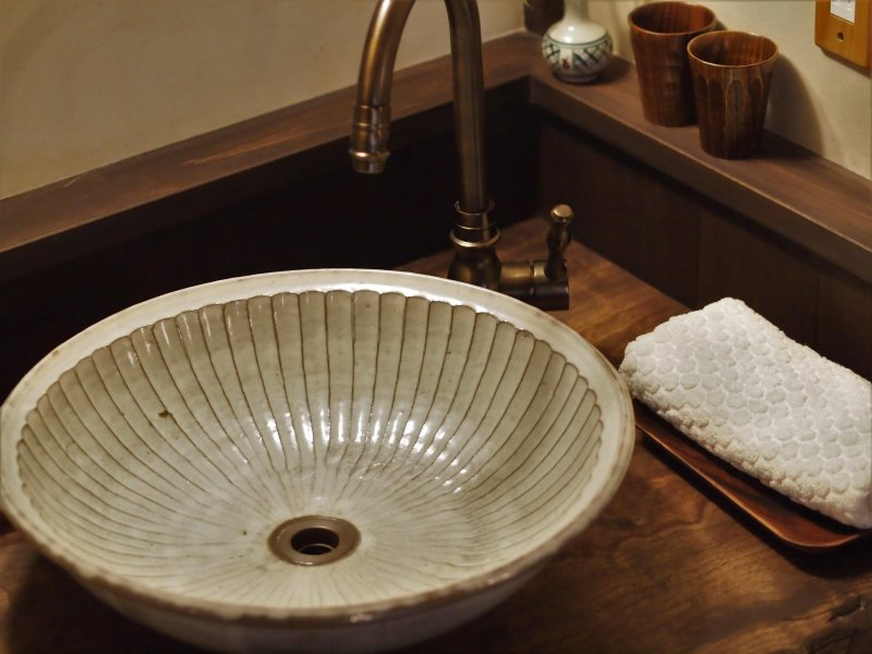 Japanese handmade washbowl on a natural camphor wood.