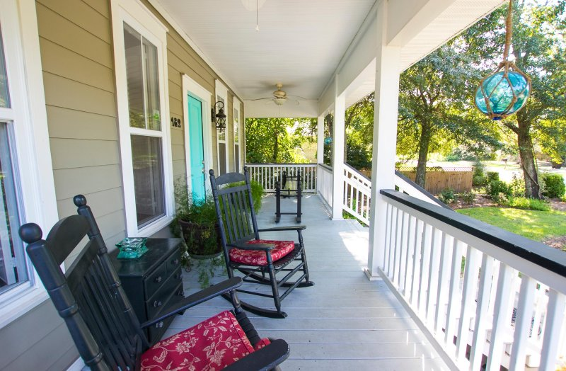 Lovely front porch. Large Lot. Beautiful Home. 5 bedroom / 4  Bath.