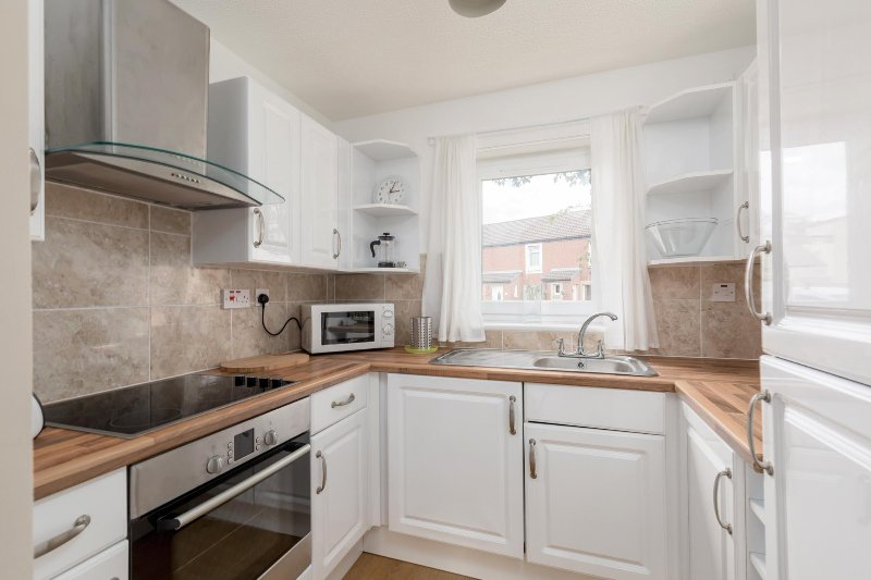 Fully equipped kitchen with washer/dryer, fridge/freezer, kettle and toaster