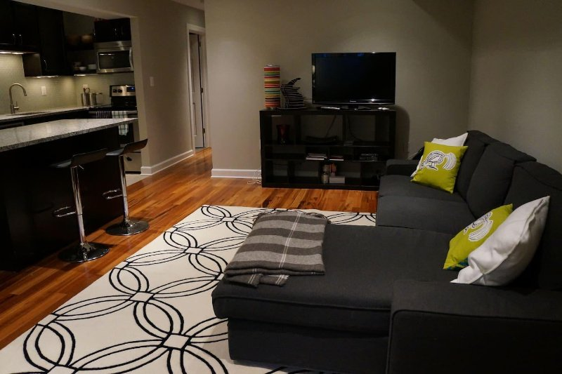 Living room, entertainment center and eating area
