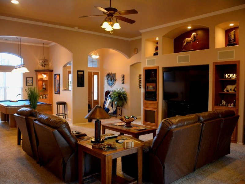 Cozy main room with theater sound system. Seats 6-8