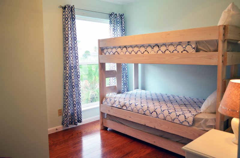 Bunk room with 3 twin beds.