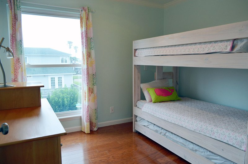 Another bunk room with 3 twin beds.