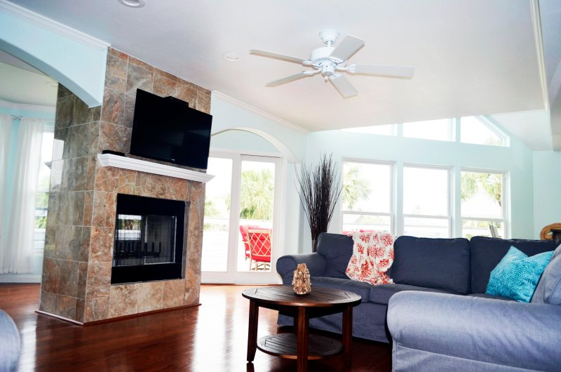Bright and inviting living room with ample seating for guests.