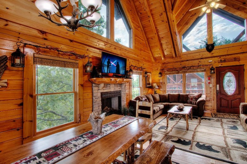 Bright open-vaulted ceiling Living Room with Stone Fireplace, plenty of seating