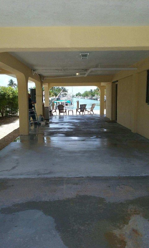 View thru carport to new 30' dock + entire length of 10/11th Sts. canal to OCEAN + GULF!